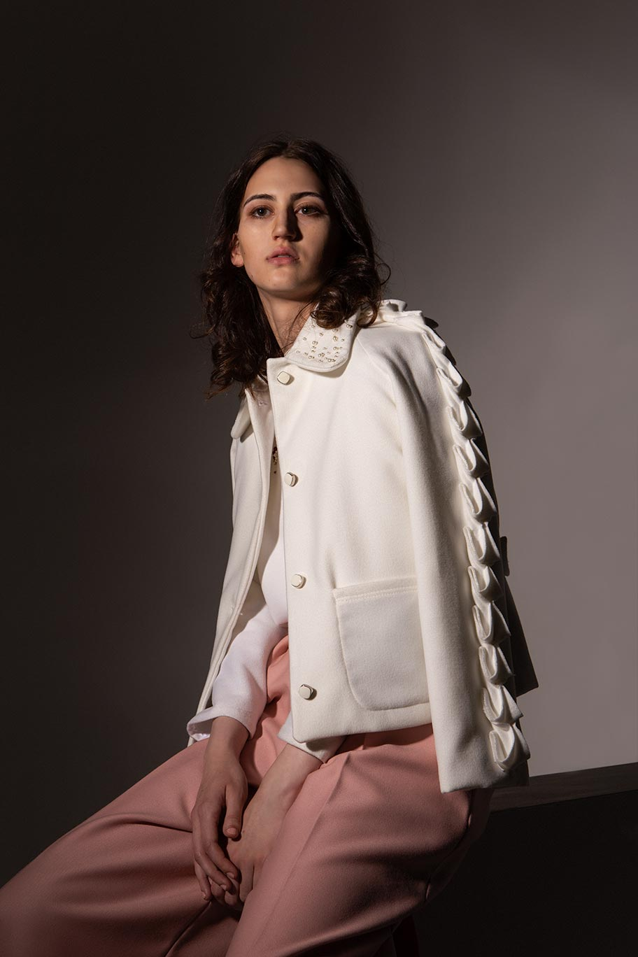 VALDONE Au - Editorial image of British white wool Alia couture coat. Made-to-measure garment made in the UK.