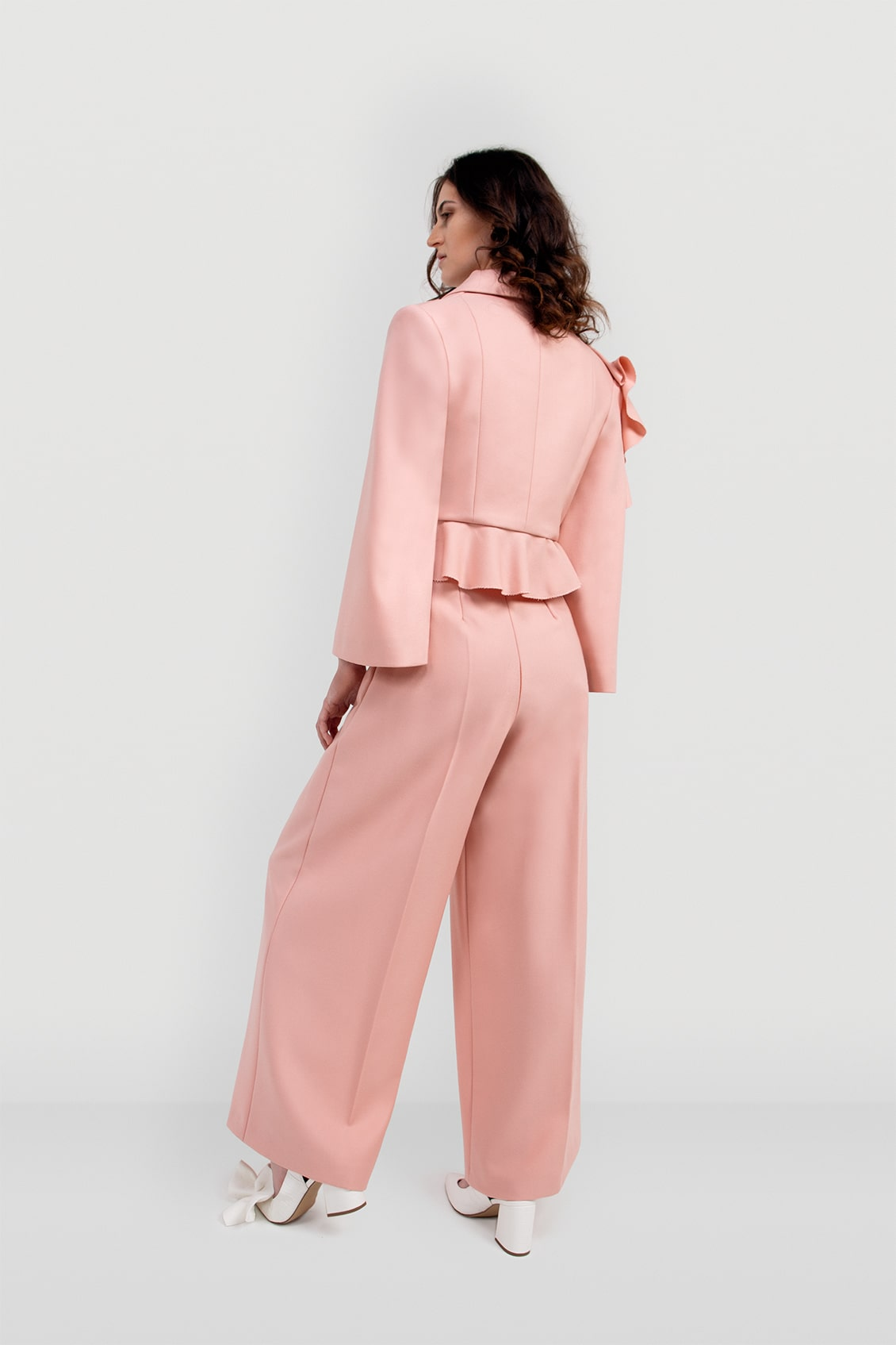 VALDONE Au - back of the wide sleeve shoulder-to-hem ruffle detail of the women's tailored suit jacket ALYSA in baby pink fine wool fabric.