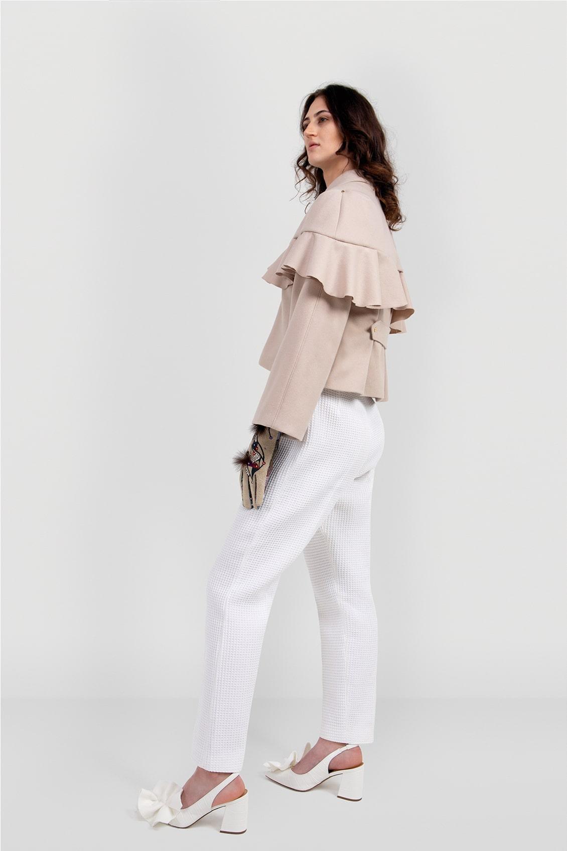 VALDONE Au - side of the beige British wool women's designer coat AUDREY. Hip length coat with detachable cape detail.