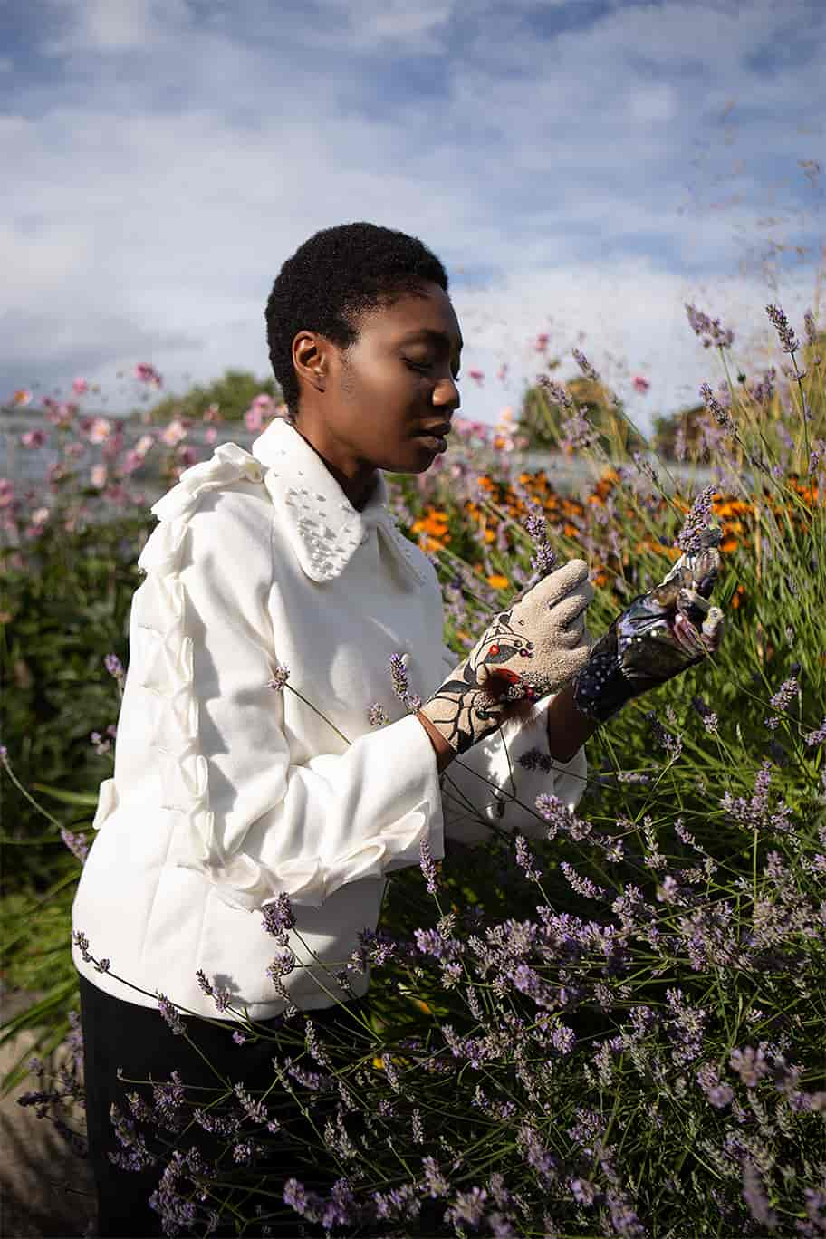 VALDONE Au - Sustainable luxury fashion. Editorial of the Alia coat with model surrounded by the lavender flowers